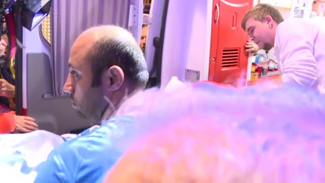 vídeos de stock, filmes e b-roll de head coach of besiktas senol gunes is seen in an ambulance after fans throw an object to his head during ziraat turkish cup semi final second leg... - senol guenes