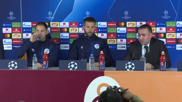 Head coach of Schalke 04 Domenico Tedesco and player Guido Burgstaller speak during a press confernce ahead of UEFA Champions League Group D soccer...