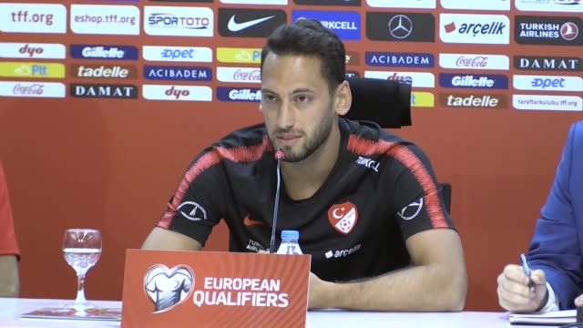 head coach senol gunes and player hakan calhanoglu of turkey attend a press conference prior to the european qualifiers group h match between turkey... - senol guenes stock videos and b-roll footage