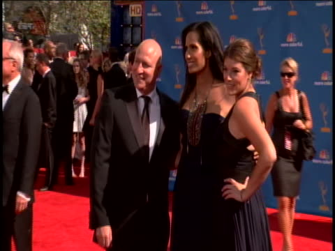 head judge tom colicchio and gail simmons on the red carpet for the 2010 emmy awards at the nokia theater in hollywood. padma is wearing a strapless... - judge entertainment stock videos & royalty-free footage