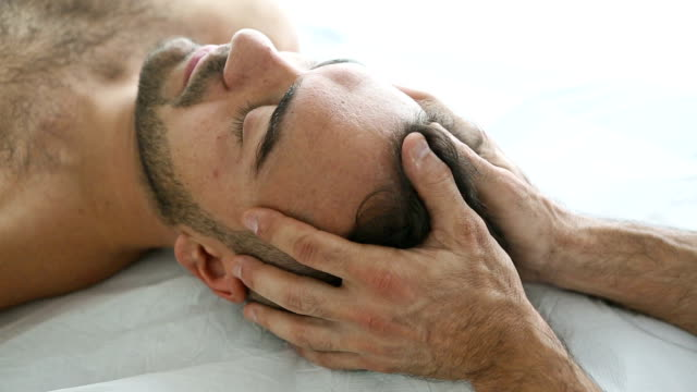 head massage on patient - osteopath stock videos & royalty-free footage