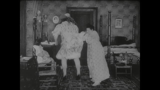 1917 head mistress spanks butcher boy (fatty arbuckle) thinking him a girl enrolled at her school - spanking stock videos and b-roll footage
