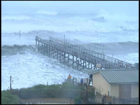 head north carolina atlantic beach during hurricane irene nice bluish tint of ws day atlantic beach pier at hotel, rain, mist, high... - north carolina us state stock videos & royalty-free footage