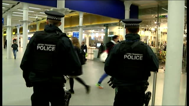 head of mi5 warns of threat to the uk st pancras station passengers along on concourse armed police on patrol sign for eurostar armed police along on... - counter terrorism stock videos & royalty-free footage