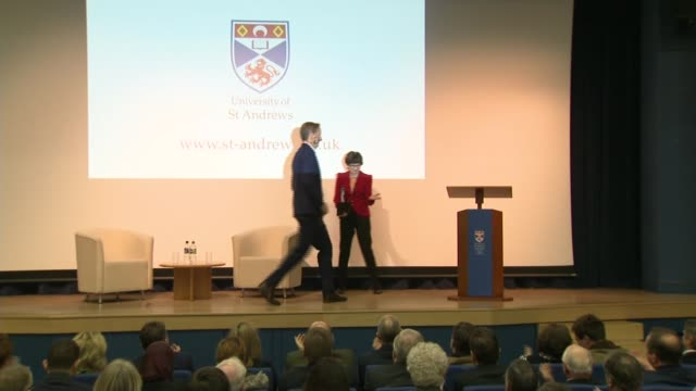 head of mi6 warns of continuing threat from russia; scotland: fife: st andrews: university of st andrews: int alex younger along on stage and up to... - st. andrews scotland stock videos & royalty-free footage