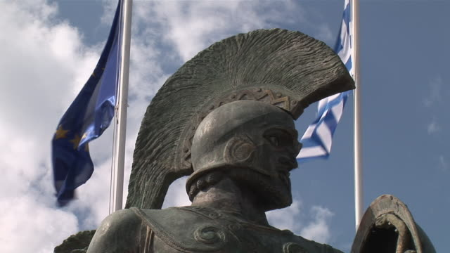CU LA Head of Spartian warrior Leonidas with helmet and flag / Taygetos peninsula, Peloponnese, Greece