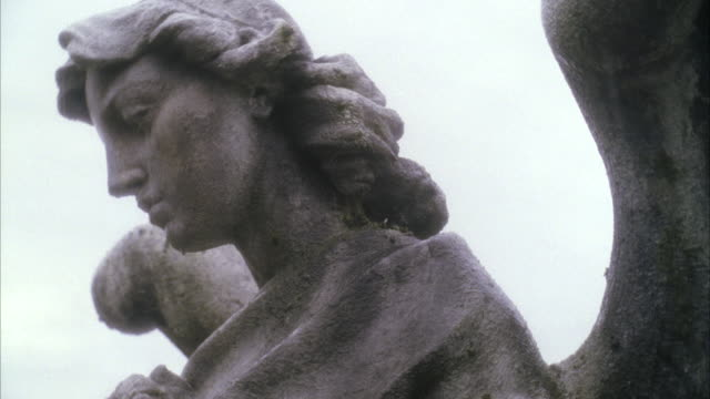 cu zo head of statue and reveal large cemetery - statue stock videos & royalty-free footage