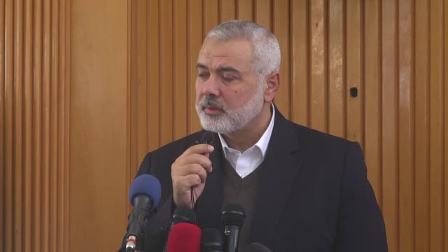Head of the Political Bureau of Hamas Ismail Haniyeh attends the funeral ceremony of 29 year old disabled Palestinian Abraham Abu Sureyya martyred...