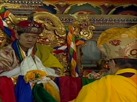 head on king jigme khesa sitting in throne to a little zoom out to include priest in shot - religious dress stock videos & royalty-free footage