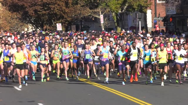 15000 head out at start on main street in manchester ct - salmini stock videos and b-roll footage