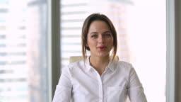 Head shot portrait attractive businesswoman talking making presentation use webcam