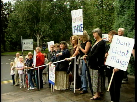 court arrivals wales abergavenny ext head teacher marjorie evans walking along to court with others/ gvs supporters chanting sot/ nut supporters with... - head teacher stock videos and b-roll footage