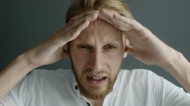 vídeos y material grabado en eventos de stock de de cefalea  - dolor de cabeza
