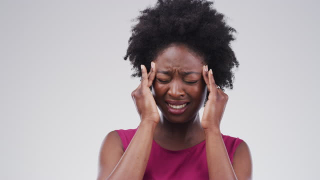 headaches can really ruin your day - grimacing stock videos & royalty-free footage