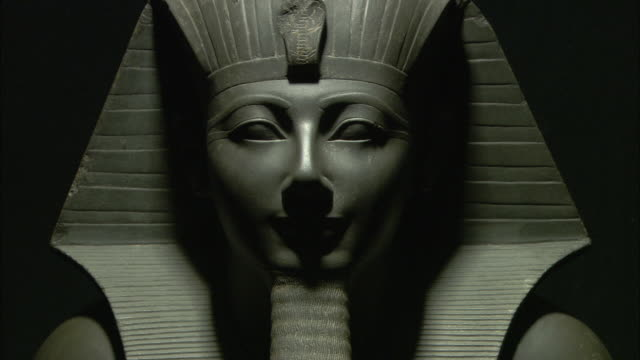 a headdress frames the shadowy face of a thutmosis iii statue at luxor museum in egypt. - headdress stock videos & royalty-free footage
