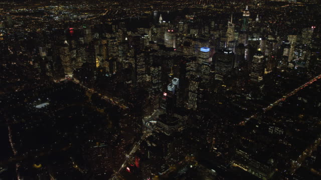heading southeast over manhattan at night toward times square, flying over columbus circle and time warner center. shot in 2011. - time warner center stock videos & royalty-free footage