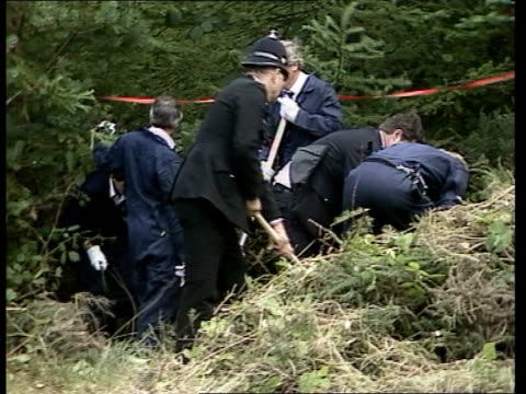 'headless body murder' police search for murder weapon uk exeter police officers search woodland following discovery of woman's headless body devon... - female beheading stock videos & royalty-free footage