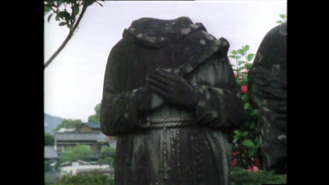 headless statues from urakami cathedral after nagasaki bomb; 1981 - decapitated stock videos & royalty-free footage