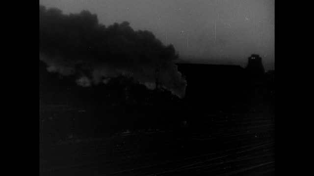 MONTAGE Headlights and trains moving at night, steam billowing from locomotive, and dawn breaking through clouds / Switzerland