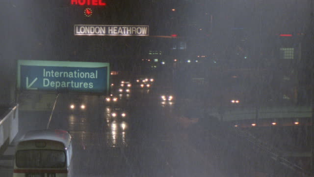 headlights glow on a rainy freeway near heathrow airport in london. - 1989 stock videos & royalty-free footage