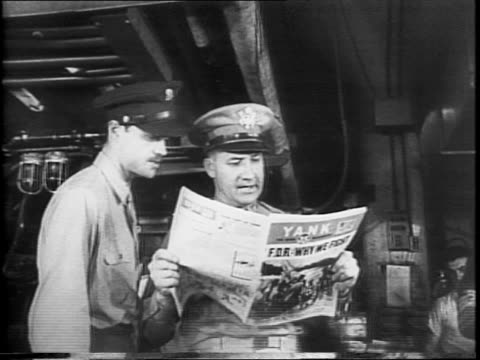 headline from the yank newspaper / newspaper press printing copies of the yank / soldier taking stacks of newspaper off the press for bundling / two... - cartoonist stock videos & royalty-free footage