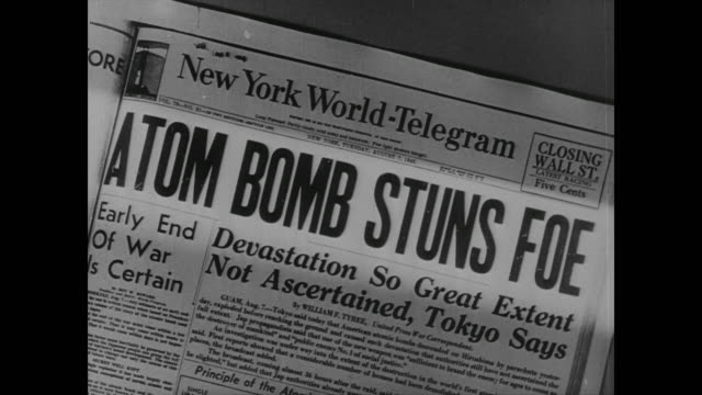 vídeos de stock, filmes e b-roll de first atomic bomb dropped on japan missile is equal to 20000 ton of tnt truman warns foe of 'rain of ruin' - primeira página de jornal