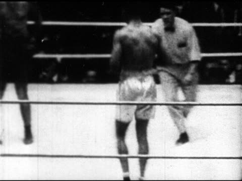 boxing headlines 'champion dempsey 3 to 1battle for title' world heavyweight champion jack dempsey boxing in ring fight w/ luis firpo dempsey being... - heavyweight stock videos and b-roll footage