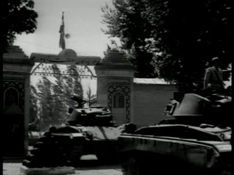 vídeos de stock, filmes e b-roll de headlines 'iran oil grab set for today' iranian tanks moving under gate one tank traveling on road peace keeping forces tank moving into oil refinery... - 1951