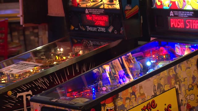 wgn headquarters bar in downtown chicago combines the love of craft beer and arcade games the simpsons and twilight zone pinball machines on october... - pinball machine stock videos & royalty-free footage
