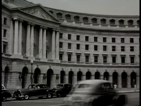 headquarters building. int man at desk in reception room. postmaster general jesse m donaldson at desk talking w/ reporters. washington d.c. - 1948 stock videos & royalty-free footage