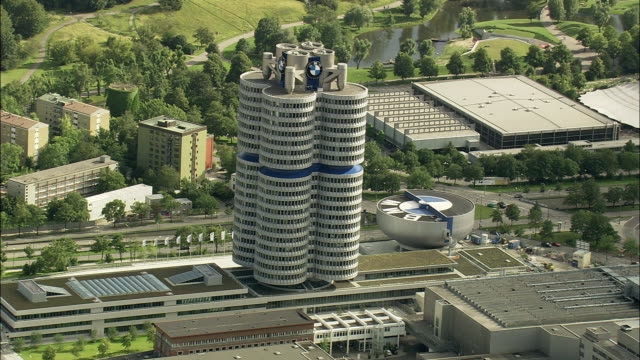 stockvideo's en b-roll-footage met aerial bmw headquarters building, munich, bavaria, germany - automobile industry