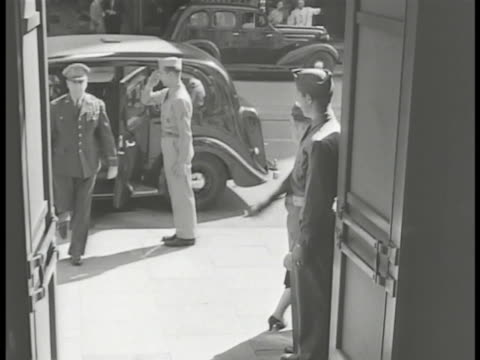 'Headquarters US Army Forces' sign TU US Flag Recalled US General MacArthur out of car into building PAN Crowd outside MacArthur out of car walking...