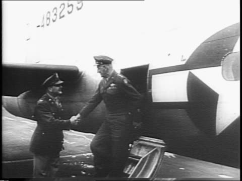 Heads of crowd at HuttLa Guardia Field / Boeing B17 bomber Army plane lands / name on plane is Boops / General Carl A Spaatz out of plane greeted by...