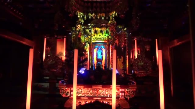 a headsetwearing buddhist priest recites a sutra to the rhythm of techno music while a buddhist statue is colorfully illuminated at the shoonji... - rhythm stock videos and b-roll footage