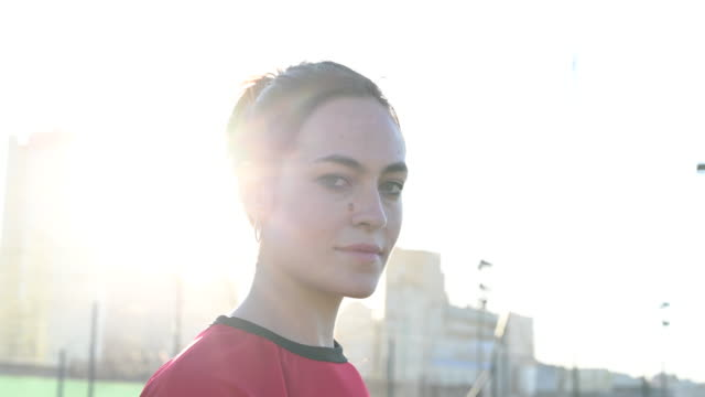 headshot of 24 year old female footballer in red jersey - human head stock videos & royalty-free footage