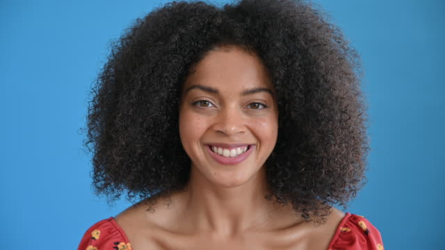 headshot of casual mixed race woman in 20s with curly hair - medium length hair stock videos & royalty-free footage