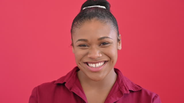 headshot of cheerful 19 year old black girl in red blouse - blouse stock videos & royalty-free footage