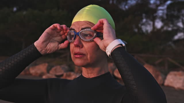 "headshot of mature female triathlete on beach at dawn - xavierarnau or ""xavier arnau serrat"" stock videos & royalty-free footage"