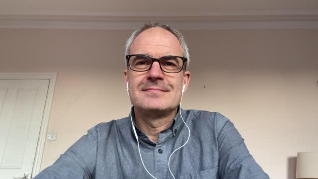 headshot of mature man on video call nodding - balding stock videos & royalty-free footage