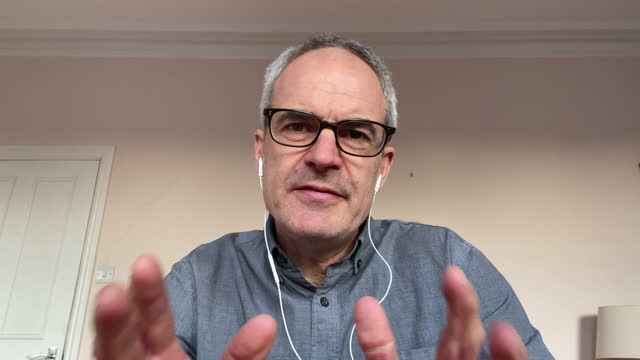 headshot of mature man on video call talking and gesturing - balding stock videos & royalty-free footage