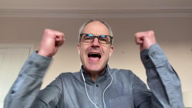 headshot of mature man on video call - balding stock videos & royalty-free footage