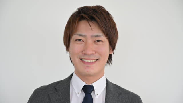 headshot of young japanese businessman in gray suit - suit jacket stock videos & royalty-free footage