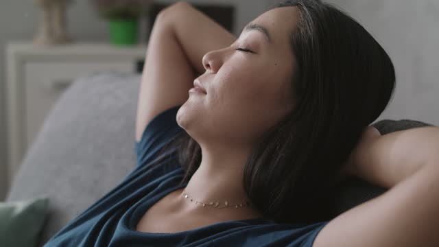 headshot of young woman relaxing with hands behind her head, falling asleep - hands behind head stock videos & royalty-free footage
