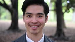 Headshot portrait of happy young Japanese man