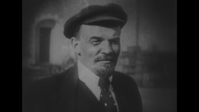 vídeos y material grabado en eventos de stock de headshot vladimir lenin wearing cap tie coat outside talking / note exact year not known - lenín