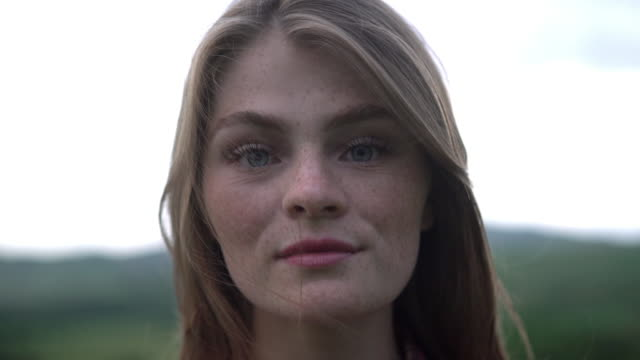 ecu headshot young woman with blue eyes and freckles - teenage girls stock videos & royalty-free footage