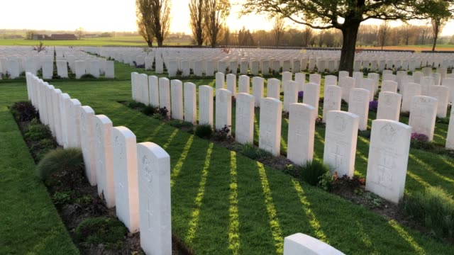headstones of fallen soldiers from the first world war are seen at the tyne cot cemetery the largest commonwealth war graves commission cemetery in... - 墓石点の映像素材/bロール