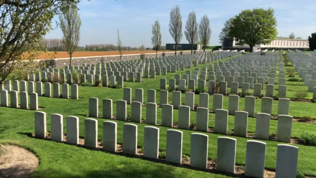 headstones of fallen soldiers from the first world war are seen at the tyne cot cemetery the largest commonwealth war graves commission cemetery in... - grab stock-videos und b-roll-filmmaterial
