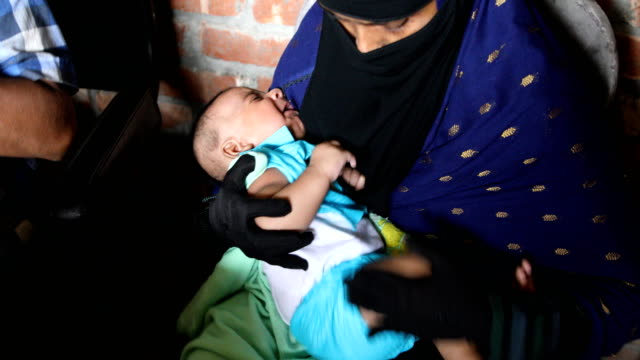 a health assistant applies a vaccine to a child in a rural area of bangladesh on july 20 2020 the expanded program on immunization was established in... - diphtheria stock videos & royalty-free footage