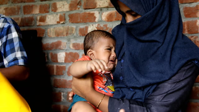 health assistant applies a vaccine to a child in a rural area of bangladesh on july 20, 2020. the expanded program on immunization was established in... - polio stock videos & royalty-free footage
